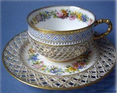 Beautiful porcelain tea cup with saucer