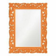 "Wall mirror with a scrolling frame in orange.Product: Wall mirrorConstruction Material: Resin and mirrored glassColor: OrangeDimensions: 41"" H x 31"" W x 1"" D Cleaning and Care: Wipe clean with damp cloth"