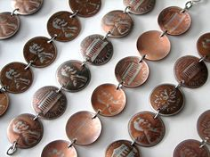Penny bracelet could be made from leftover coins from any country. Maybe coins from each country on your trip?