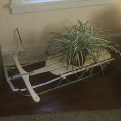 It is amazing what some sand paper, primer and yoga muscles can do! I found this vintage sled at my local market and after I spent a few days sanding, priming and painting it made an awesome plant stand. I kept the colors simple (cream and silver) and it adds a touch of whimsy to my bedroom without taking away from the clean, simple and serene look of the space. I was tempted to keep with the original color scheme but the wood had seen better days so repainting was my best bet.