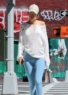 We can see you: Gigi Hadid showed off her assets in a sheer top and skinny trousers as she strolled in New York on Sunday