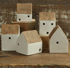 Together, these homes create a free-form village of ceramic cottages, each one organically formed and unique in shape, ready to pop up as a snug centerpiece or sweet mantle display. These cottages are sold in an assorted set of 5.