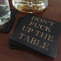 Whenever you hand somebody a coaster this is what you are really saying. Dont Fuck Up The Table!  These witty and fun coasters are handmade out of baltic birch wood. Each piece is then hand stained and laser etched.  They work great, make a fantastic conversation piece, and are just super fun and clever.  Each coaster measures 4 x 4 and is 1/4 thick. Each order consists of 4 wood coasters.