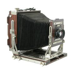 £6865 Ebony SV810E 8x10 Field Camera. The 8x10 version of Ebony's classic folding camera. Constructed entirely of quarter-sawn Macassar ebony heartwood, aged for at least 20 years. As with all Ebony cameras, the metal parts of both the SV810E are made of solid titanium. The uniquely thin and supple yet durable calfskin bellows are hand-made to Ebony's specifications. The hand-strap is made of genuine cordovan leather.