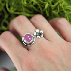 "156 Likes, 9 Comments - Chisai Designs (@chisaidesigns) on Instagram: ""Pardon my winter hands! This is one more shot of a cherry blossom and ruby ring that I re-sized for…"""