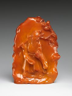 Dongfang Shuo Stealing the Peach of Longevity  Period:      Qing dynasty (1644–1911)  Culture:      China  Medium:      Amber  Dimensions:      H. 6 1/2 in. (16.5 cm); W. 4 1/2 in. (11.4 cm)  Classification:      Amber  Credit Line:      Bequest of Edmund C. Converse,