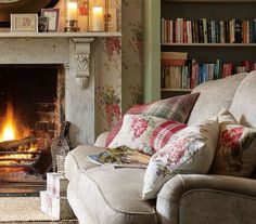 Keeping warm by the open fire in a cottage living room.
