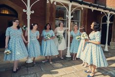 1940s inspired bridesmaids in pale blue dresses.  Photography http://www.assassynation.co.uk/