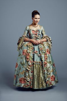 This gown fascinates me. The row of bows in graduated sizes down the front of the bodice...inspired!!