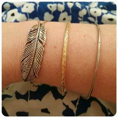 Bangle Bundle! 3 costume bangles:  one rose colored leaf, one yellow gold with designs and one plain silver. Jewelry