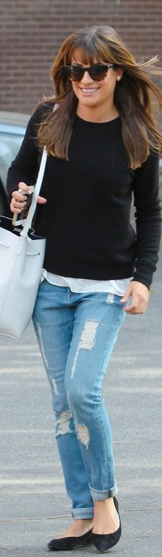 Who made Lea Michele's black sweater, brown sunglasses, blue ripped jeans, and white bucket handbag