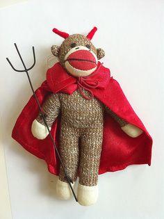 sock monkeys :) What a cute little devil