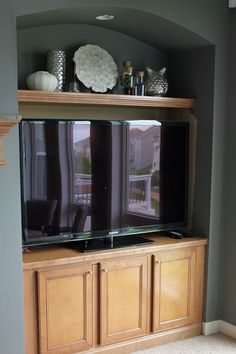 Shelf over TV in niche.  from Teal and Lime...