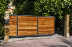 Advantage Tigerwood™ is a strong and reliable choice for your home entrance. AdvantageLumber.com ®  #advantagelumber #tigerwood #exotic #hardwood #miami #florida #gate #home #entrance #durable Sliding Wooden Gates, Wood Fence Gates, Sliding Gate, Front Gate Design, Door Gate Design, Entrance Gates, House Entrance, Balcony Grill Design, Modern Fence Design