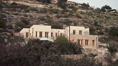 Walls made of hemp and lime, and local stone make up this sand-coloured house on a hill in northern Israel, which Haifa-based studio Tav Group designed for environmentally conscious artists.