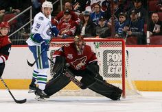 GLENDALE, AZ - JANUARY 26: Goalie Mike Smith #41 of the Arizona Coyotes keeps his eye on the puck as Brandon Sutter #20 of the Vancouver Canucks positions himself in front of the net during the first period at Gila River Arena on January 26, 2017 in Glendale, Arizona. (Photo by Norm Hall/NHLI via Getty Images)