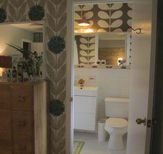 Bathroom Interior by cabin + moss. Ikea wall hung vanity. Orla kiely wallpaper. Brass gold tone faucet.