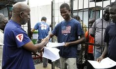 A man receives a certificate with a clean bill of health from the Elwa Ebola clinic in Monrovia.