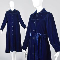 The color of this 1970s coat is so stunning in person, and in a beautiful lush velvet! Details: This listing is for one coat. Textile is unmarked, dark blue velvet. Medium weight, good as a spring or fall coat. Coat is fully lined. Long sleeves. Can be worn without the belt for a swing coat style, or belted at the waist. Size Marked: Unmarked  Approximate Size: X-Small to Medium **Please Check Measurements to be Sure!  Fabric: Unmarked, Velvet  Closure: Buttons, Belt Label: Jacobsens…
