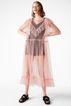 This is the stuff summer dreams are made of: a long and loose sheer mesh dress in dreamy pink; with a v-shaped ruffle in front and another around the hem. Elasticated waist for added freedom and comfort.