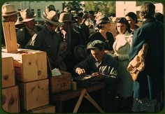*Distributing surplus commodities. St. Johns, Arizona, October 1940. Reproduction from color slide. Photo by Russell Lee. Prints and Photographs Division, Library of Congress