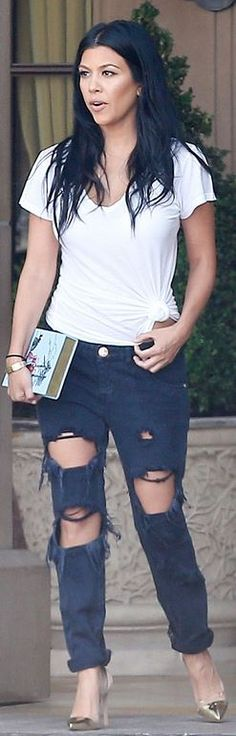 Who made  Kourtney Kardashian's gold jewelry, gray ripped jeans, book clutch handbag, and silver cap toe pumps?