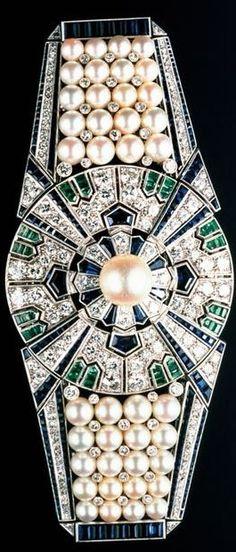 Mikimoto Sash Clip Yaguruma made from cultuvated Akoya pearls, sapphires, diamonds and emeralds.