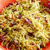 Springtime Broccoli Slaw with cranberries, sesame seeds, pumpkin seeds and green onions