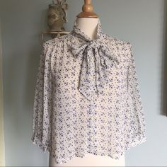 ⚓️⚓️Hostess pick⚓️⚓️ The perfect sheer blouse from Twenty one. Delicate ivory with navy blue cute ⚓️s. Super cute with a pair of white shorts or skirt. Preloved and beautiful. One small pull in front barely visible. Happy to take picture of it for you. XX1 Tops Blouses