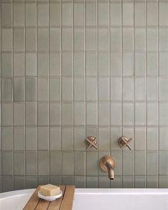 modern bathroom design iwth modern tile, modern stacked gray tile with gold bathtub faucet, tile over bathtub in neutral bathroom design, Neutral Bathrooms Designs, Simple Bathroom Designs, Modern Bathroom Design, Bathroom Interior Design, Neutral Bathroom Tile, Bathroom Canvas, Natural Bathroom, Bathroom Inspiration, Home Decor Inspiration