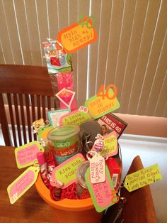 "40th Birthday Bucket 'O Fun! Fill a ""wash bucket"" (stuffed with paper at bottom) with fun gifts/sayings to celebrate!  I added the actual This is 40 DVD and tag ""This is 40"", Flip flops and Red Hots - ""Still Flipping Hot at 40"", a blow pop - ""Forty doesn't blow"", lip gloss - ""kiss this 40"", perfume - ""Forty doesn't stink!"", kite - ""Flyin high at forty!"", fun cup/glass - ""Cheers to Forty"", pitcher with cups/cute sayings - ""Still foxy, sexy, sassy and fabulous at Forty! Add till hearts…"