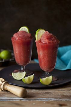 A delicious frozen watermelon daiquiri with a splash of coconut water and a hint of basil on DrizzleandDip.com #cocktail