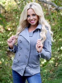 This must have jacket does not need a description! It is oh so perfect. It has a banded bottom, pocket on the arm, and a hood. It is available in this Fall's must have colors: Charcoal, Black, Grey, and Purple.
