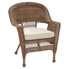 Showcasing a classic wicker design and tan cushion, this eye-catching chair is the perfect addition to your veranda or patio seating group. ...