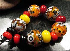 Louise sunshine colours encased twistie by KitzbitzArtBeads, £26.50