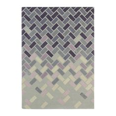 Invigorate your space with this Ash Grey Agave Rug from Ted Baker. Featuring a bold geometric design in ash grey tones, it transforms your home with its vivid design. Expertly hand tufted, it is made
