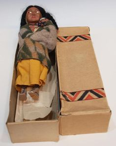 Skookum indian doll,with papoose ,with her original box.