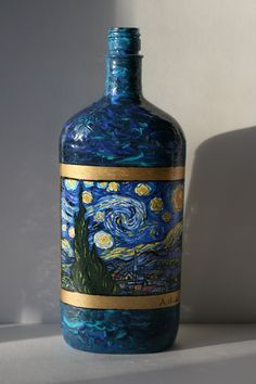 Vincent Van Goghs Starry Night hand painted on a recycled liquor bottle. The bottle can also be used as a lamp. I have more pictures as a lamp.
