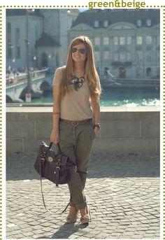 Green pants, beige / khaki colored shirt, scarf, big sunglasses