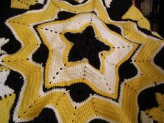 Yellow, black and white multi- pointed afghan.