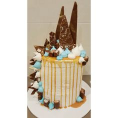Chocolate shards and merigues falling down the cake! Birthday cake with caramel drip