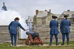 Cannon fired by soldiers at the Fortress of Louisbourg in Cape Breton, Nova Scotia