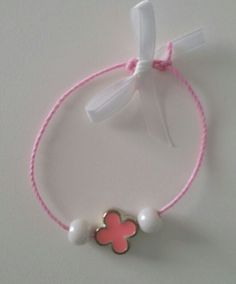 Pink bracelet  with cross and bead used as martyrika witness pin