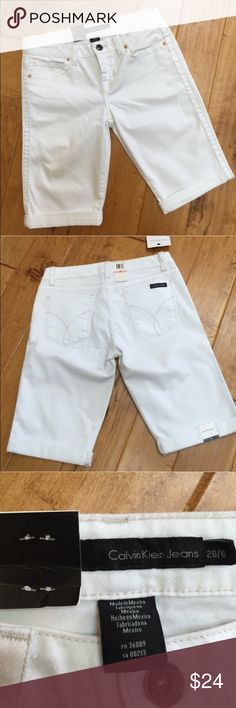 """NWT Bermuda shorts NWT pair of Calvin Klein denim Bermuda shorts. They are white and size 28/6. Total length is approximately 20"""", approximate measurement of the waist when laid flat is 16"""", and inseam is approximately 11.5"""" with the shorts rolled. There is a zipper fly and five pockets. Calvin Klein Jeans Shorts Bermudas"""