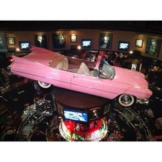 Inside Hard Rock Cafe, Universal Studios, Orlando, Fl  Pink Cadillac hanging from the ceiling