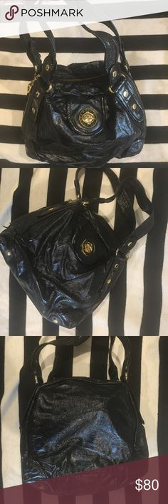 Marc by Marc Jacobs large bag patent leather black hi! i'm moving and trying to get rid of some fun stuff out of my closet. bought this 5 years (ish?) ago from the marc by marc jacobs boutique in chicago. always been a favorite because of the shiny leather and big gold lock 😀 the outside of the bag looks nearly perfect & the inside is in good used condition! i don't have the dustbag anymore!  feel free to make offers.... Marc By Marc Jacobs Bags Shoulder Bags