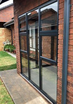 Glassflex® installation using HBS Nuklip system with 6.38mm clear laminated Intruderprufe glass, finished in a charcoal colour to match existing aluminium