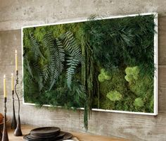 Hanging Fern and Moss Wall Art in your dinning room is like planting a vertical jungle on your wall. It's made from real, living plant material. Yet — at least according to this review of the Fern and Moss Wall Art — it doesn't require watering and isn't a magnet for bugs. The large size in the photo above sells for over $1,000 but other options go for as little as $ 198.