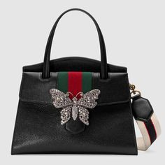 44756d9de6e (Brown leather Gucci Totem medium top handle bag from Gucci featuring front  flap with metal