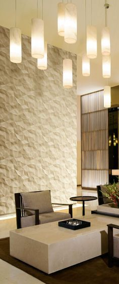 Cool textured wall panels & light pendants                                                                                                                                                     More